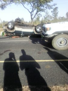 A car driving past the accident scene